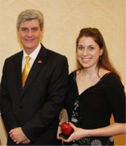 Phil Bryant congratulates Nicole Nutting for her HEADWAE award.